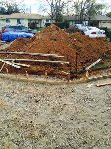 My front yard - STILL a mess with its growing dirt stockpile.