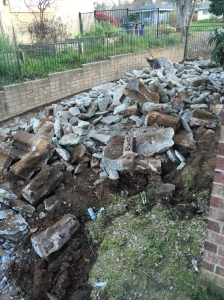 The pile of rubble that was once our side yard/RV pad and 3 adobe planer boxes.