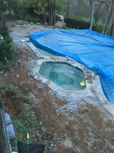 Our poor pool has lost its diving board and pool deck.