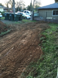 Front of the house, former yard and flower bed, where we are installing a new patio.