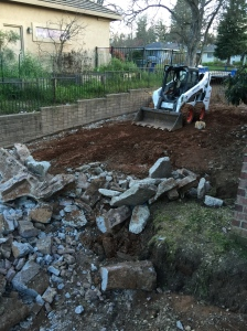 Side yard/RV pad ... old concrete steadily being carted off.